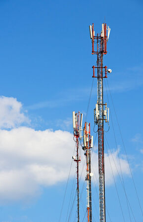 telco: GSM Antenna against blue sky Stock Photo