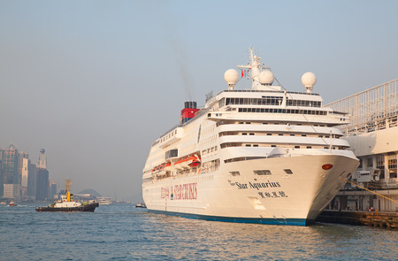 HONG KONG - DECEMBER 3: Cruise liner 'Star Aquarius' at Kowloon pier on December 3, 2010 in Hong Kong, China. Hong Kong is ine of the most popular destinations in the world with ove 40 millions visitorsyear.
