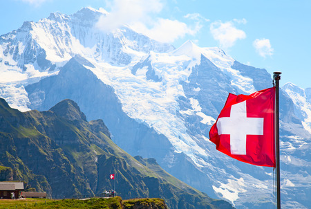 jungfraujoch: Swiss flag on the top of Mannlichen (Jungfrau region, Bern, Switzerland) Editorial