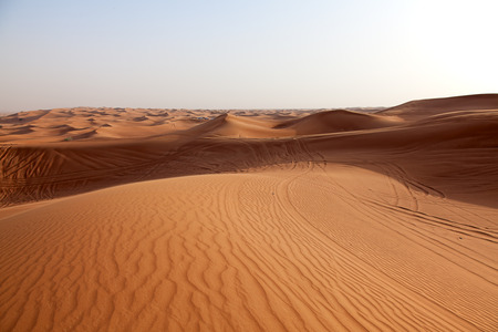 Red sand Arabian desert near Dubai, United Arab Emirates photo