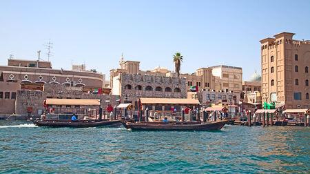 bur dubai: Traditional dhow ferry boats on the Dubai creek Editorial