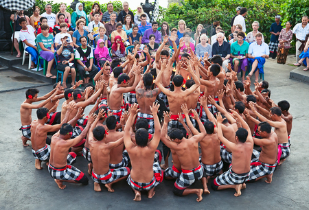 ceremonial: DENPASAR - JULY 27: Traditional Balinese Kecak dance shown in Denpasar, Bali, Indonesia on July 27, 2010. Kecak (also known as Ramayana Monkey Chant) is very popular cultural show on Bali Editorial