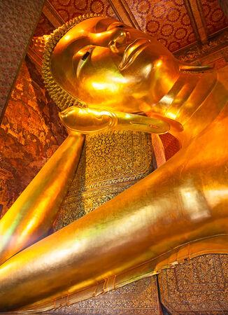Famous Reclining Buddha statue in the Wat Pho, Bangkok, Thailand photo