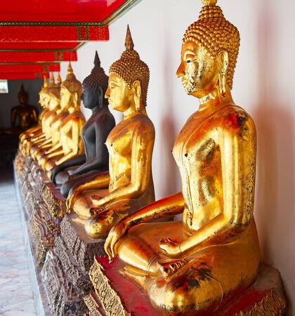 Buddha statues in the Wat Pho, Bangkok, Thailand photo