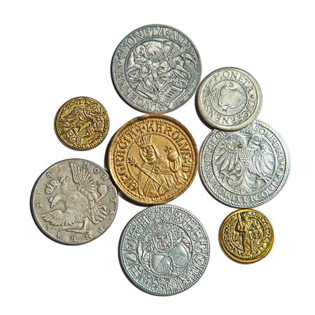 Collection of the medieval coins on the white background photo