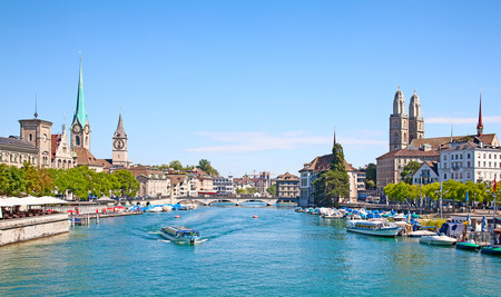 Limmat river and famous Zurich churches Stok Fotoğraf