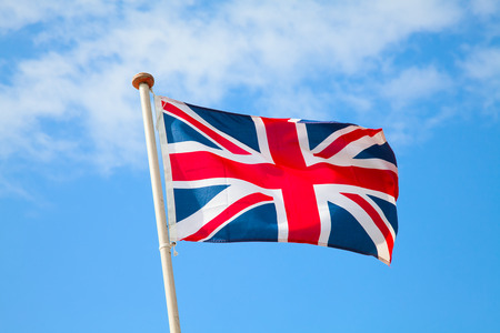UK flag in the blue sky 免版税图像