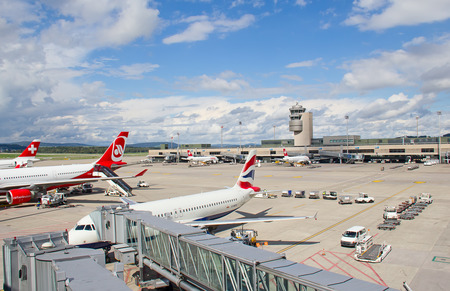 ZURICH - SEPTEMBER 21:Airplanes preparing for take off on September 21, 2014 in Zurich, Switzerland. Zurich International Airport is one of the major Europian Hub and home port of Swiss airline.