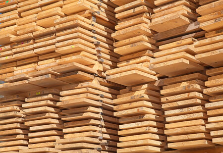 wood plank: Stack of new wooden studs at the lumber yard