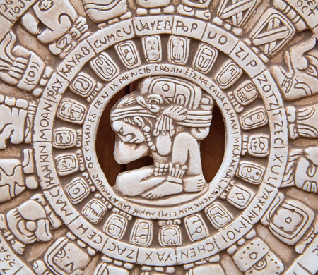 Fragment of the Mayan symbolic sun carved on the stone photo