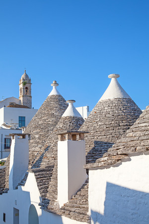 trulli: Sunset over traditional Trulli houses of the Apulia region Stock Photo