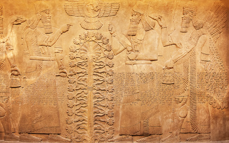 Ancient sumerian stone carving with cuneiform scripting 스톡 콘텐츠