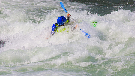 kayaker: Female kayaker in the white water of tghe river