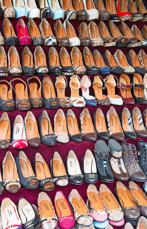 faked: ISTANBUL - MAY 3: Faked shoes on sale on the narrow street around Grand Bazaar on Mal 3, 2015 in Istanbul, Turkey. Area around Grand Bazaar is well known seeling place for replica shoes, bags and jeans