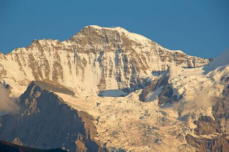 aletsch: Sunset light on the north face of mount Jungfrau in swiss alps