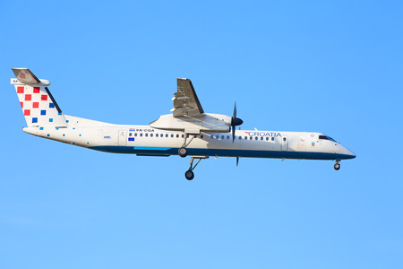 long haul journey: ZURICH - JULY 18: Bombardier Q400 Croatian Airlines landing in Zurich airport after short haul flight on July 18, 2015 in Zurich, Switzerland. Zurich airport is home port for Swiss Air and one of the biggest european hubs. Editorial