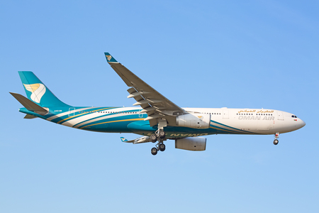 long haul journey: ZURICH - JULY 18: Oman Air Airbus A330 landing in Zurich airport after short haul flight on July 18, 2015 in Zurich, Switzerland. Zurich airport is home port for Swiss Air and one of the biggest european hubs.