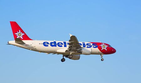 haul: ZURICH - JULY 18: Airbus A319, Edelweiss Air landing in Zurich airport after short haul flight on July 18, 2015 in Zurich, Switzerland. Zurich airport is home port for Swiss Air and one of the biggest european hubs.