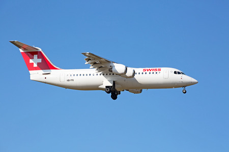 hubs: ZURICH - JULY 18: AVRO RJ100 landing in Zurich airport after short haul flight on July 18, 2015 in Zurich, Switzerland. Zurich airport is home port for Swiss Air and one of the biggest european hubs.