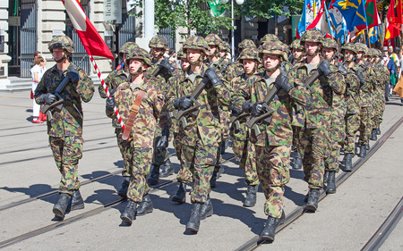 helvetica: ZURICH - AUGUST 1: Infantry divisionof the Swiss army taking part in the Swiss National Day parade on August 1, 2012 in Zurich, Switzerland.