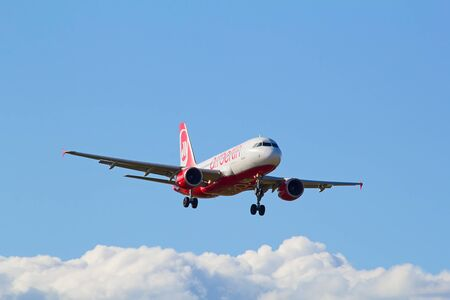long haul journey: ZURICH - JULY 18: A-319 Air Berlin landing in Zurich airport after short haul flight on July 18, 2015 in Zurich, Switzerland. Zurich airport is home port for Swiss Air and one of the biggest european hubs.