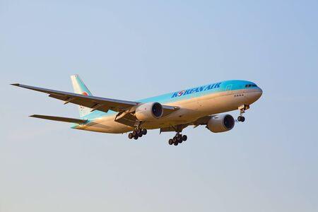 long haul journey: ZURICH - JULY 18: Boeing-777 Korean air landing in Zurich at sunset on July 18, 2015 in Zurich, Switzerland. Zurich airport is home for Swiss Air and one of biggest european hubs.