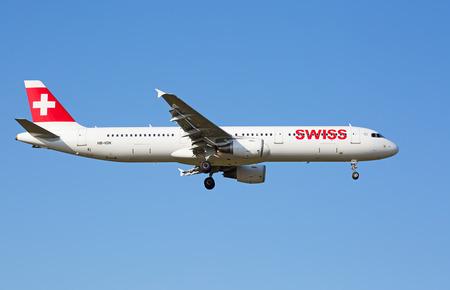 haul: ZURICH - JULY 18: Airbus A-321 landing in Zurich airport after short haul flight on July 18, 2015 in Zurich, Switzerland. Zurich airport is home for Swiss Air and one of the european hubs.