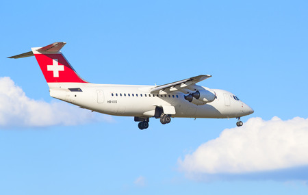 haul: ZURICH - JULY 18: AVRO RJ100 landing in Zurich airport after short haul flight on July 18, 2015 in Zurich, Switzerland. Zurich airport is home port for Swiss Air and one of the biggest european hubs.