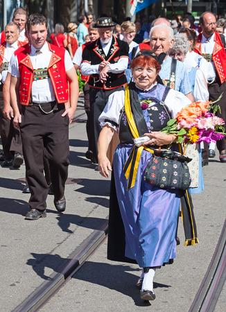 helvetica: ZURICH - AUGUST 1: Swiss National Day parade on August 1, 2012 in Zurich, Switzerland. Woman in a historical costume.