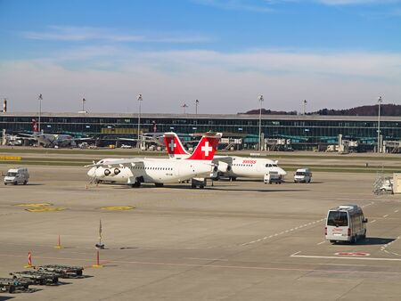 hubs: ZURICH - JULY 18: AVRO RJ100 in Zurich airport after short haul flight on July 18, 2015 in Zurich, Switzerland. Zurich airport is home for Swiss Air and one of the biggest european hubs.