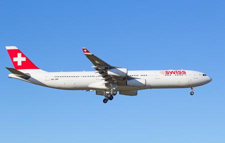 hubs: ZURICH - JULY 18: Airbus A340 Swiss landing in Zurich after short haul flight on July 18, 2015 in Zurich, Switzerland. Zurich airport is home for Swiss Air and one of biggest european hubs.