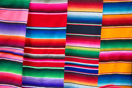 Traditional mexican bright stripped fabric on the market