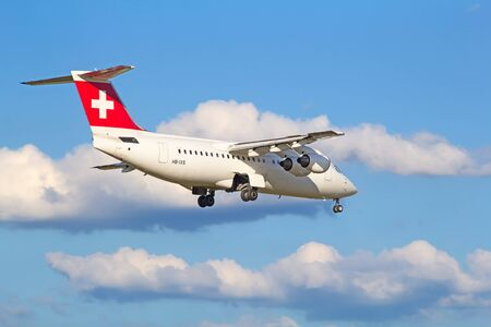 long haul journey: ZURICH - JULY 18: AVRO RJ100 landing in Zurich airport after short haul flight on July 18, 2015 in Zurich, Switzerland. Zurich airport is home port for Swiss Air and one of the biggest european hubs.