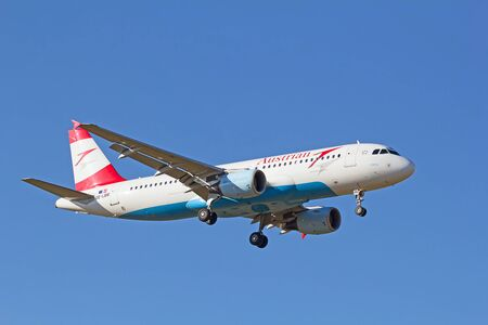 haul: ZURICH - JULY 18: A-318 Austrian Airlines landing in Zurich airport after short haul flight on July 18, 2015 in Zurich, Switzerland. Zurich airport is home port for Swiss Air and one of the biggest european hubs. Editorial