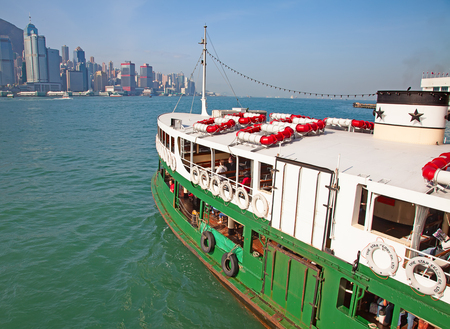 hong: HONG KONG - DECEMBER 3: Ferry Solar star leaving Kowloon pier on December 3, 2010 in Hong Kong, China. Hong Kong ferry is in operation for more than 120 years and is one of attractions of the city.