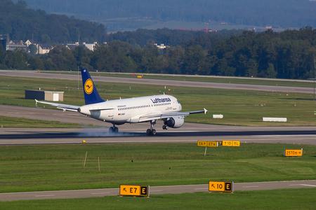 long haul journey: ZURICH - AUGUST 23: A-320 Lufthansa landing in Zurich airport after short haul flight on July 18, 2015 in Zurich, Switzerland. Lufthansa is leading european airline