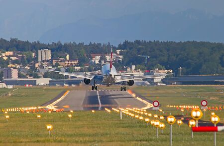 long haul journey: ZURICH - JULY 18: Airbus A-319 Swiss Air landing in Zurich after short haul flight on July 18, 2015 in Zurich, Switzerland. Zurich airport is home for Swiss Air and one of biggest european hubs. Editorial