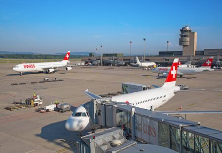 long haul journey: ZURICH - JULY 18: Swiss airlines at terminal A of Zurich airport on July 18, 2015 in Zurich, Switzerland. Zurich airport is home for Swiss Air and one of biggest european hubs.