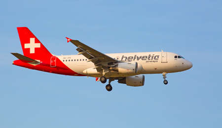 long haul journey: ZURICH - JULY 18: Helvetic airways A-319 landing in Zurich airport after intercontinental flight on July 18, 2015 in Zurich, Switzerland. Zurich airport is home port for Swiss Air and one of the biggest european hubs.