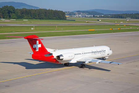 long haul journey: ZURICH - JULY 18: Helvetic airways taxiing in Zurich after short haul flight on July 18, 2015 in Zurich, Switzerland. Zurich airport is home for Swiss Air and one of biggest european hubs. Editorial