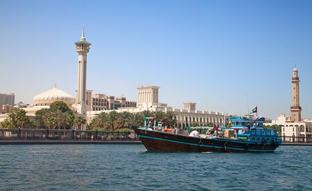 bur dubai: Traditional dhow ferry boats on the Dubai creek Stock Photo
