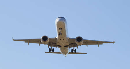 long haul journey: Aircraft performing landing at the airport Stock Photo