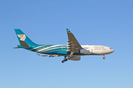 hubs: ZURICH - JULY 18: Oman Air A-330 landing in Zurich airport after intercontinental flight on July 18, 2015 in Zurich, Switzerland. Zurich airport is home port for Swiss Air and one of the biggest european hubs.