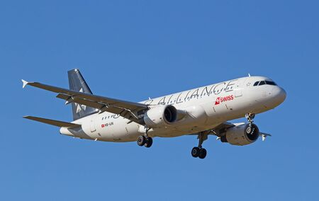 long haul journey: ZURICH - JULY 18: Airbus A-318 landing in Zurich airport after short haul flight on July 18, 2015 in Zurich, Switzerland. Zurich airport is home port for Swiss Air and one of the biggest european hubs.