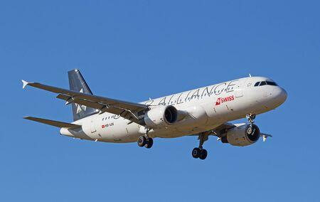 hubs: ZURICH - JULY 18: Airbus A-318 landing in Zurich airport after short haul flight on July 18, 2015 in Zurich, Switzerland. Zurich airport is home port for Swiss Air and one of the biggest european hubs.
