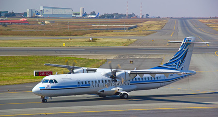 johannesburg: JOHANNESBURG - APRIL 18:ATR-42 Air Botswana taxiing afterflight on April 18, 2012 in Johannesburg, South Africa. Johannesburg Tambo airport is the busiest airport in Africa