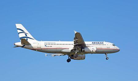 long haul journey: ZURICH - JULY 18: Aegean A-320 landing in Zurich airport on July 18, 2015 in Zurich, Switzerland. Zurich airport is home port for Swiss Air and one of the biggest european hubs.
