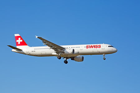 hubs: ZURICH - JULY 18: Swiss A-320 landing in Zurich airport after intercontinental flight on July 18, 2015 in Zurich, Switzerland. Zurich airport is home port for Swiss Air and one of the biggest european hubs.