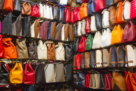 faked: ISTANBUL - MAY 3: Faked bags on sale on the narrow street around Grand Bazaar on Mal 3, 2015 in Istanbul, Turkey. Area around Grand Bazaar is well known seeling place for replica shoes, bags and jeans
