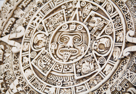 prognostication: Fragment of the Mayan symbolic sun carved on the stone